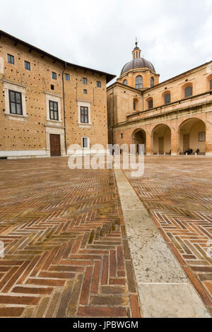 View of the medieval Piazza Rinascimento and arcades beside Palazzo Ducale Urbino Province of Pesaro Marche Italy - Stock Photo