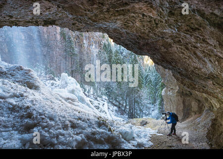 frozen waterfall in the cave Europe, Italy, Trentino Alto Adige region, Trento district, Non valley, Tret city - Stock Photo