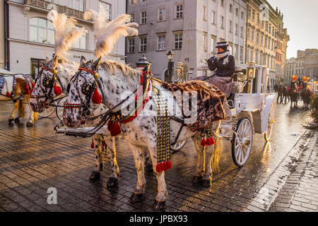 Krakow, Poland, North East Europe. Horse drawn carriages in Main Market Square. - Stock Photo