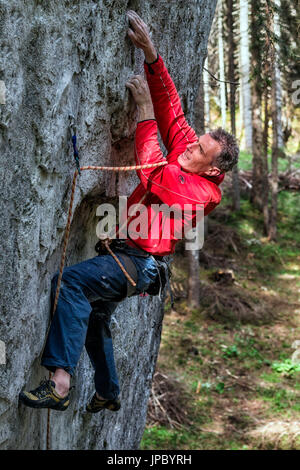 Free climbing, rock climbing in natural cliff. Climber in action on a rock path equipped. Gares, Dolomites, Veneto, - Stock Photo