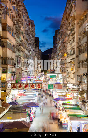 Night market in busy Fa Yuen Street in Mong Kok, Hong Kong, China. The area is popular with tourists and locals - Stock Photo