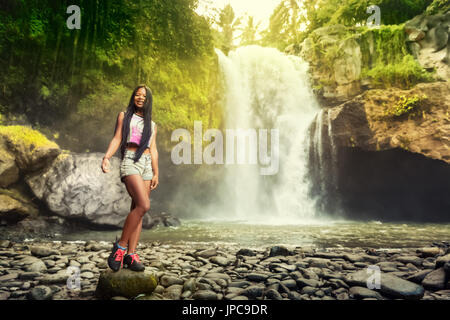 young travel woman backpacker enjoy amazing view tropical waterfall jpc9dr