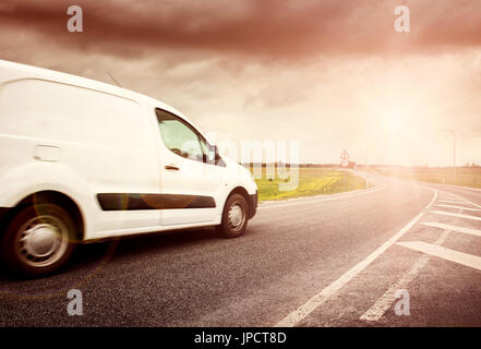 asphalt road on with a small truck - Stock Photo