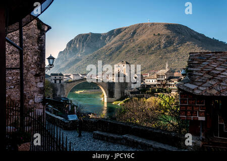 Stari Most Bridge and Old Town in Mostar, Bosnia Herzegovina - Stock Photo