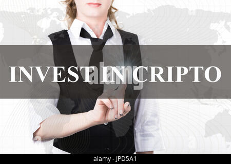 businesswoman in a jacket and tie pressing invest in cripto button of a virtual screen. exchange and production - Stock Photo