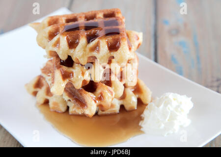 Maple syrup waffle with whipped vanilla ice cream - Stock Photo