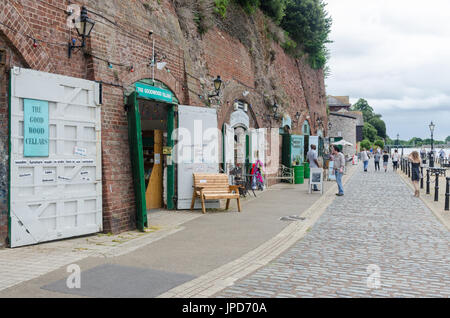 Shops and restaurants in the cellars on The Quay on the bank of the River Exe in Exeter, Devon - Stock Photo
