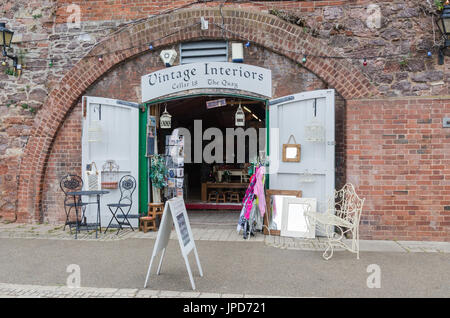 Shop in the cellars on The Quay on the bank of the River Exe in Exeter, Devon - Stock Photo