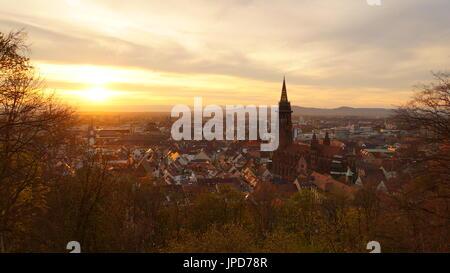Romantic evening mood over the City of Freiburg im Breisgau from Kanonenplatz with brilliant view over the city - Stock Photo