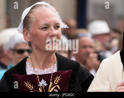 A senior lady dressed in traditional costume in a parade for the Fete des Bordeuses, Pont L'Abbe, Bigouden, Finistere, - Stock Photo