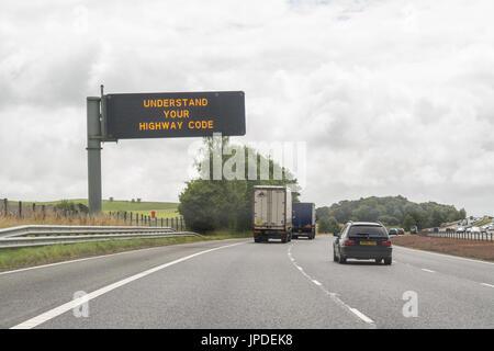 Understand your highway code sign on overhead gantry sign on uk motorway - Stock Photo