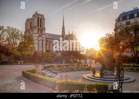 Paris, Notre Dame cathedral against sunrise in France - Stock Photo