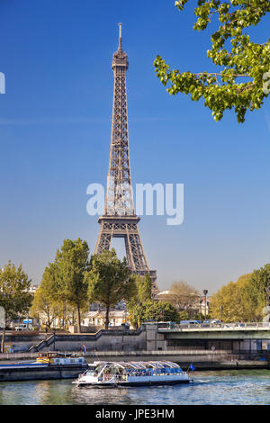 Famous Eiffel Tower with boat on Seine in Paris, France - Stock Photo