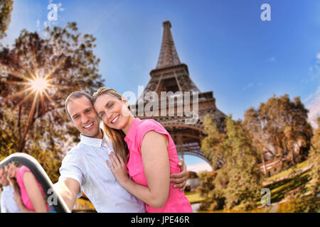 Couple Taking Selfie by famous Eiffel Tower in Paris, France - Stock Photo