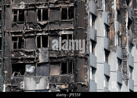 Close up view of the remains of Grenfell Tower, a residential  block of flats. At least 80 people died following - Stock Photo