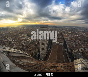 Florence, Tuscany, Italy. Sunset from the top of Cupola del Brunelleschi and Santa Maria del Fiore with Giotto tower. - Stock Photo