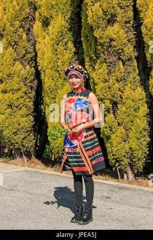 Young girl dressed with the traditional attire of Yunnan, in China - Stock Photo