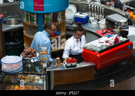 Waiters at cafe in Adelaide Arcade, Rundle Street Mall, Adelaide, South Australia. - Stock Photo