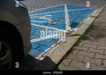 Clsoe on car parked in the disabled parking - Stock Photo