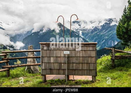 The Gams Hut mountain refuge shower with a view located above Mayrhofen-Finkenberg in the Austrian Zillertal Alps - Stock Photo