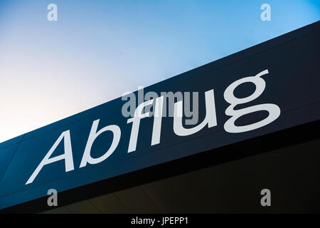 Lettering Abflug at the entrance to Tenerife South Airport Reina Sofia, Tenerife, Canary Islands, Spain - Stock Photo