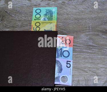 Australian dollars in book. One hundred dollars, fifty, twenty, ten, five dollar notes, - Stock Photo