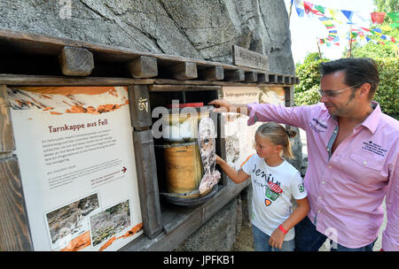 Leipzig, Germany. 1st Aug, 2017. Visitors look at an information stand in the newly opened Himalayan landscape enclosure - Stock Photo