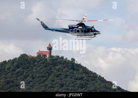 Czech police officers with police dogs flies by a helicopter during the training session of police dogs specializing - Stock Photo