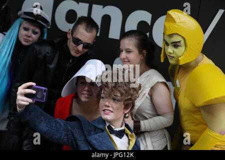 London, UK. 2nd Aug, 2017. Cosplayers pose during a photocall for the 'Into the Unknown : A Journey through Science - Stock Photo