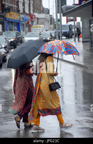 London, UK. 2nd Aug, 2017. Heavy rain in Battersea, London in the first week of school holidays Credit: JOHNNY ARMSTEAD/Alamy - Stock Photo