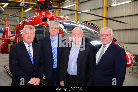 Moy, UK. 02nd Aug, 2017. Air Ambulance Northern Ireland (AANI) trustees Terence and Raymond Donnelly, Rodney Connor - Stock Photo
