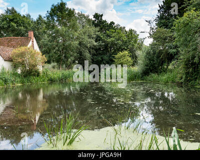 Willy Lott's cottage at Flatford Mill, as seen in the painting The Hay Wain by the artist John Constable. Suffolk, - Stock Photo