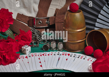 Still life image showing classic props used by Magicians. Cups and balls, flowers, chains, straight jacket, silk - Stock Photo