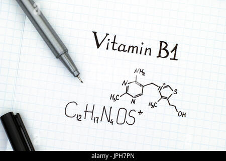 Chemical formula of Vitamin B1 with black pen. Close-up. - Stock Photo