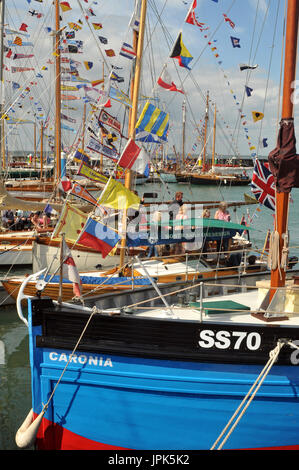 Old gaff rigged yachts and boats at the old gaffers festival for yachtsmen and sailors at Yarmouth on the Isle of - Stock Photo