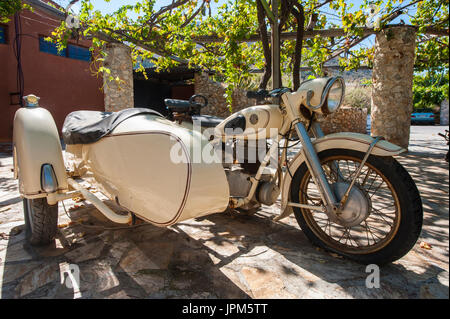 An old BMW motorbike with a side car in beautiful condition - Stock Photo
