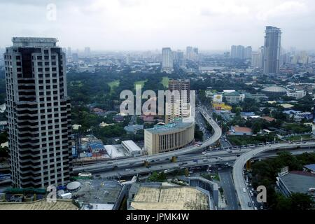 METRO MANILA, PHILIPPINES - JULY 31, 2017: Aerial view of residential and commercial areas and establishments in - Stock Photo