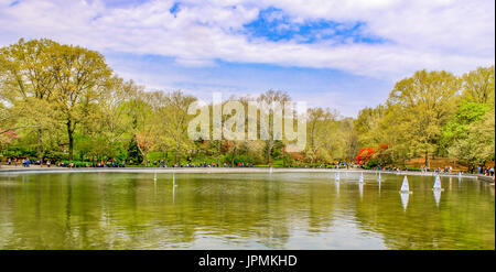 New York City/Central Park April 11, 2009:  Remote controlled sailboats skim across the lake at Central Park on - Stock Photo