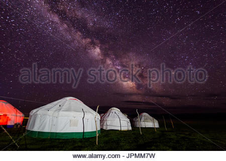 Group of yurts against the starry sky at night in the desert - Stock Photo
