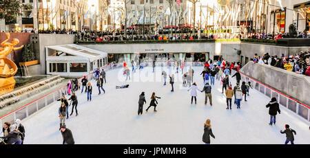 Ice skaters at Rockefeller Plaza - Stock Photo