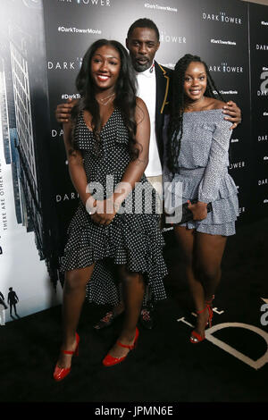 NEW YORK-JUL 31: (L-R) Isan Elba, Idris Elba and guest attend 'The Dark Tower' special screening at the Museum of - Stock Photo