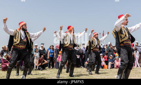 Unidentified people playing traditional folklore with their ethnic clothes at a show.It is popular in Turkey.ISTANBUL, TURKEY, May 13, 2017