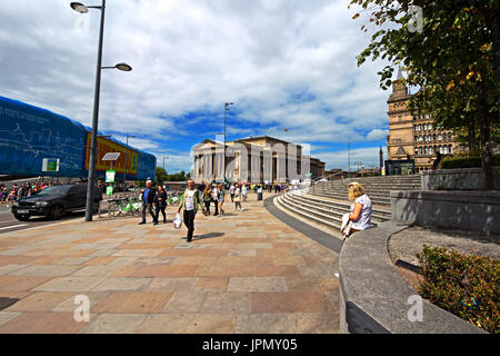 People out and about on Lime Street Liverpool with St Georges Hall in the distance - Stock Photo