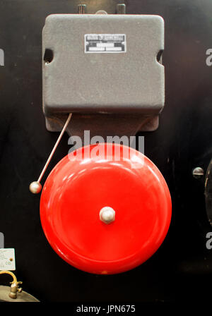 A vintage red fire alarm bell. - Stock Photo