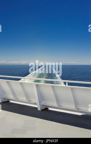 Eastern view of the Strait of Georgia from a ferry deck, BC Ferries, British Columbia, Canada on a bright sunny - Stock Photo