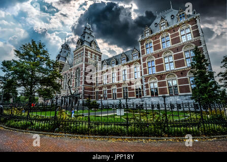 The Rijksmuseum in Amsterdam looking particularly dramatic with storm clouds overhead - Stock Photo