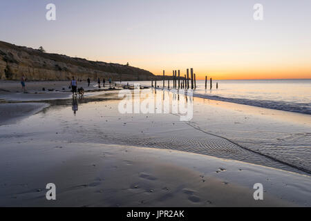 PORT WILLUNGA BEACH, SOUTH AUSTRALIA / AUSTRALIA - DECEMBER 15, 2015: People walking on the beach, enjoying the - Stock Photo