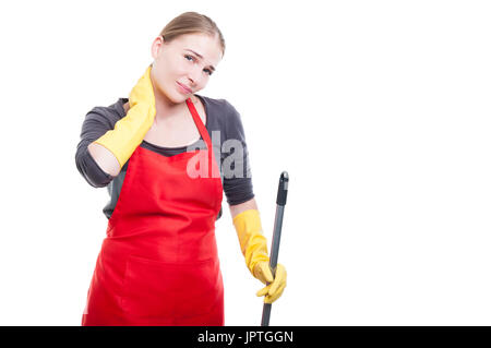 Beautiful housekeeper with mop or broom feeling pain in the neck isolated on white with copyspcae - Stock Photo