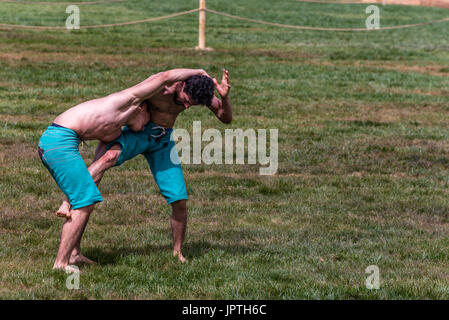 Unidentified shalwar(shalvar) gurescileri (kuroshio/wrestlers). Shalwar wrestling is a kind of traditional Turkish - Stock Photo