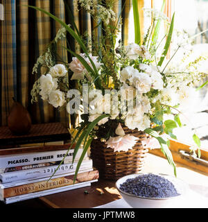Flowers and books on window sill - Stock Photo